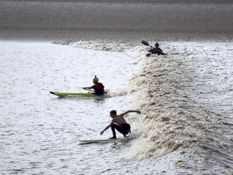 River Severn Bore Surfers